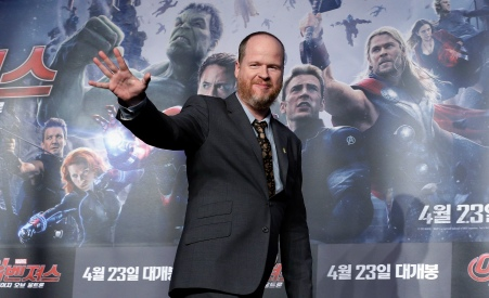 "U.S. director Joss Whedon waves during a press conference to promote his latest film ""Avengers: Age of Ultron"" in Seoul, South Korea, Friday, April 17, 2015. The movie will open on April 23 in South Korea. (AP Photo/Ahn Young-joon)"